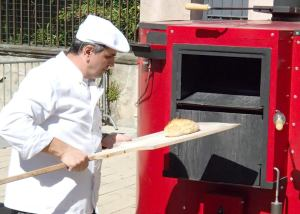 Fête du Pain - Baker working the wood fired oven