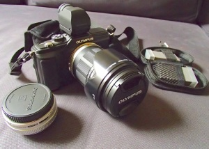 "Olympus E-PL2 Mirrorless Digital Camera and Electronic Viewfinder with an Olympus M.Zuiko 14-150 mm Zoom Lens with lens hood and an Olympus M.Zuiko 17 mm ""pancake lens"""