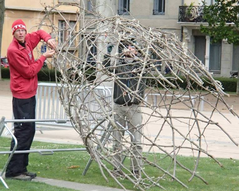 """Franco-Canadian artist Marc Walker working on one of his """"Invités du Coeur"""" (""""Guests of the Heart"""") sculptures in Square Gambetta."""
