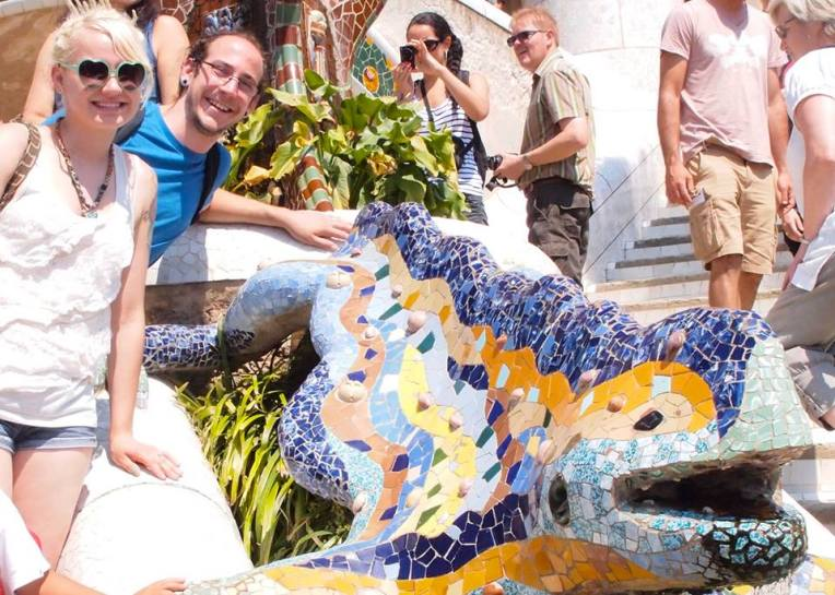 "Liz and Adam pose with ""El Drac"" Gaudí's multicolored mosaic salamander"