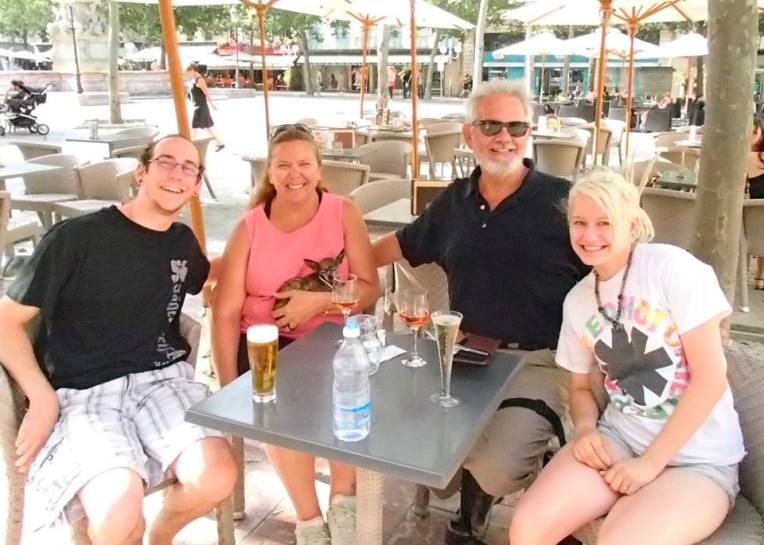 Adam, Tracy, Kiara, Alan, and Liz take a wine, beer, and champagne break in Place Carnot in the Bastide of Carcassonne