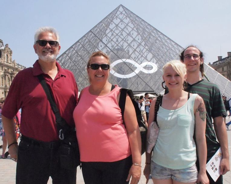 Alan, Tracy, Liz, and Adam in front of the Pyramid at the Louvre Museum in Paris