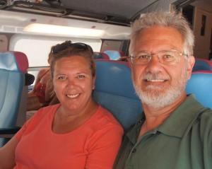 Tracy and Alan traveling by rail