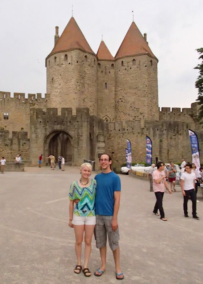 Liz and Adam at the Narbonne gate of the medieval city of la Cité de Carcassonne