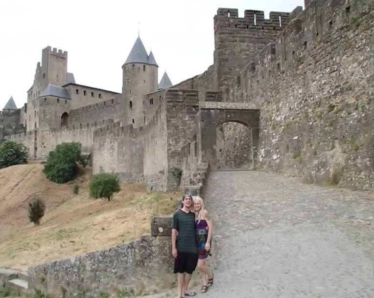 Adam and Liz in front of the Aude Gate of the medieval city la Cité de Carcassonne