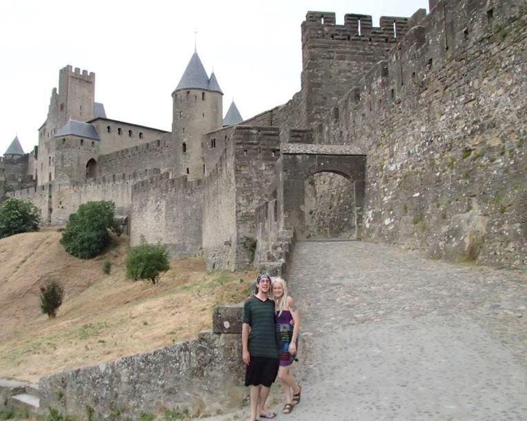 Adam and Liz in front of the Aude Gate of the medieval city la Cité de Carcassonne
