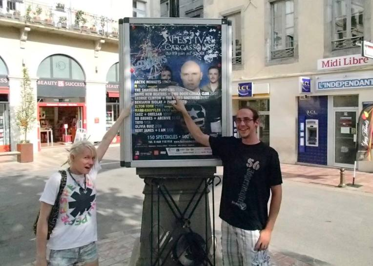Liz and Adam pointing out a Smashing Pumpkins sign in Place Carnot