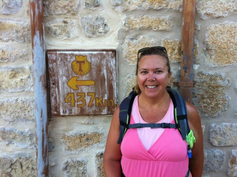Tracy at kilometer marker in Castrojeriz