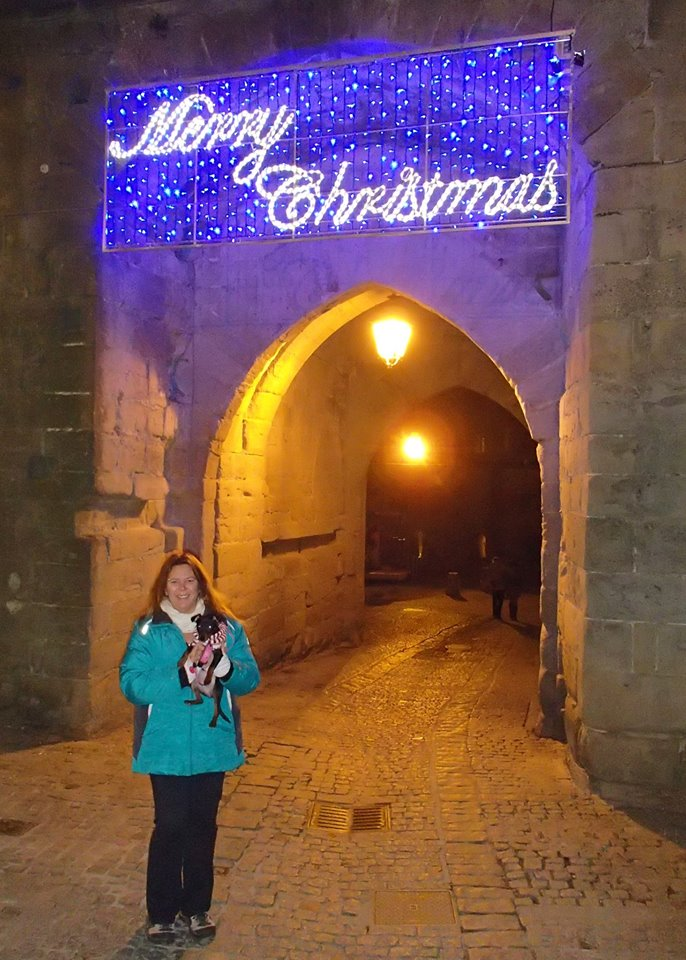 Tracy and Sami  walking in the medieval la Cité de Carcassonne after visiting the Christmas craft fair.