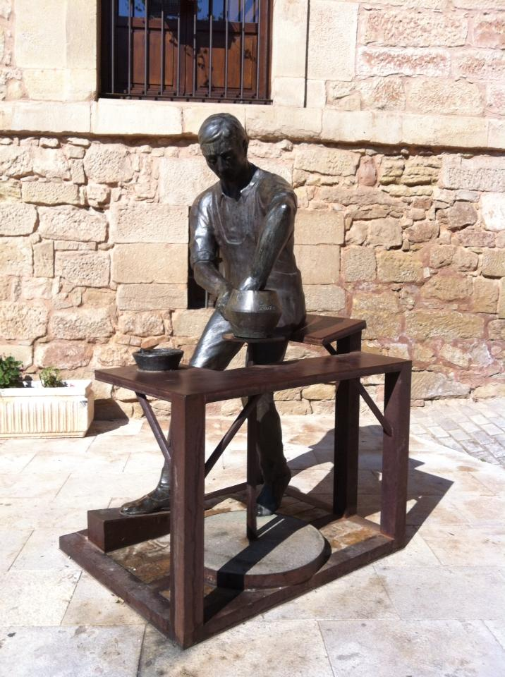 Bronze sculpture of ceramic artisan in Navarette