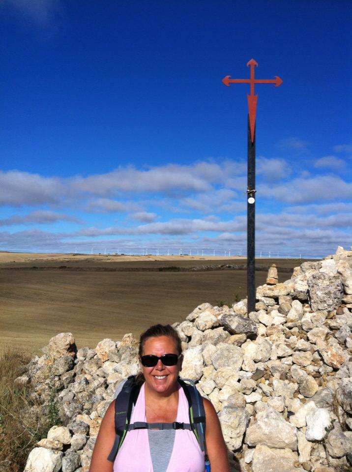 Tracy at the Cross of Santiago near Fuente de Praotorre on the Meseta