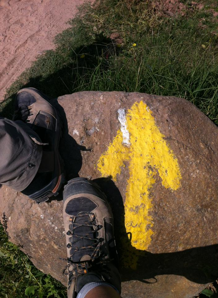 Boots and yellow arrow rock, near Navarette