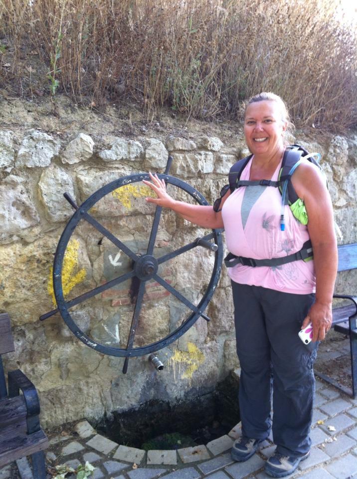 Tracy at pilgrim fountain in Boadilla del Camino