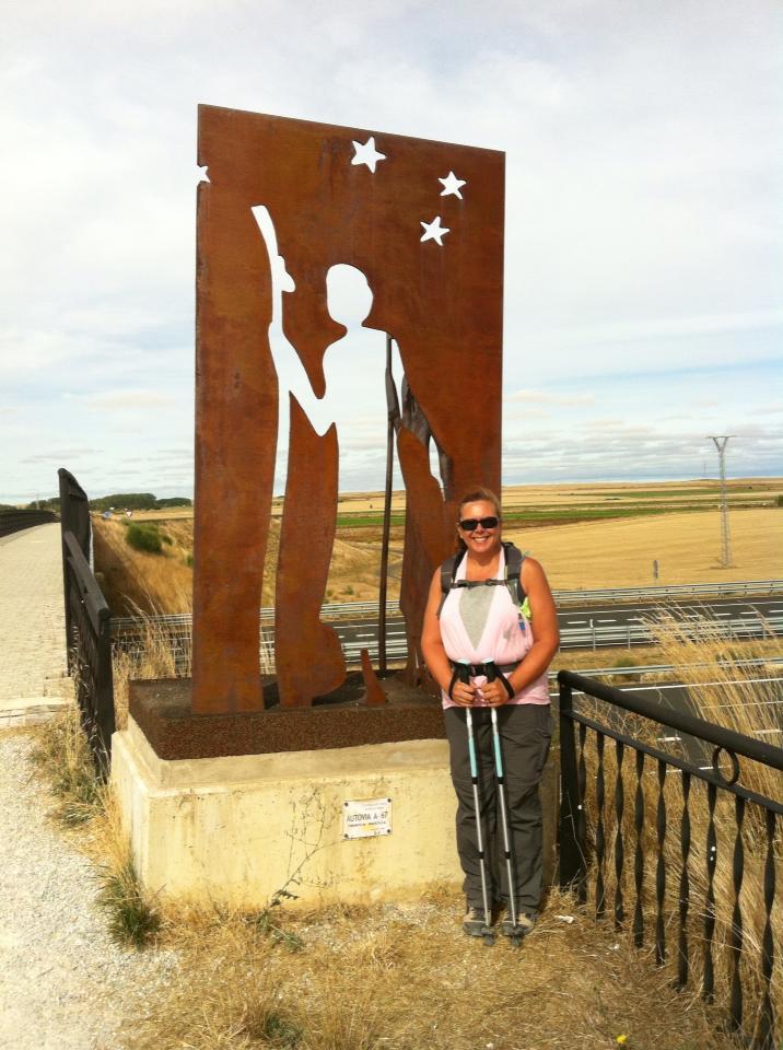 Tracy at pilgrim sculpture near overpass outside Itero de la Vega