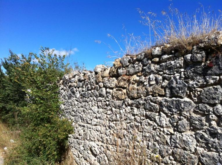 Rock retaining wall near Ages