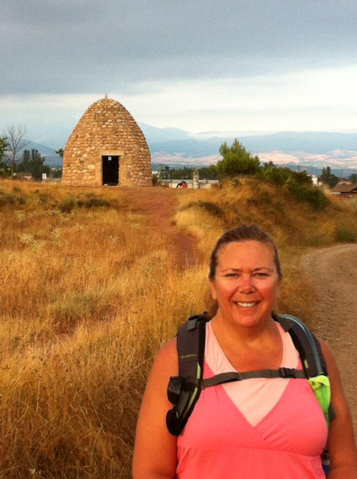 Tracy at the Beehive Hut dwelling near Najera