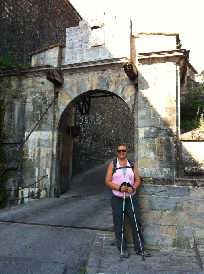 Tracy at the drawbridge entrance to Pamplona
