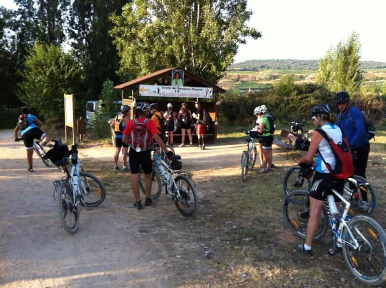 Cyclists getting their credentials stamped in Pantano de la Grajera