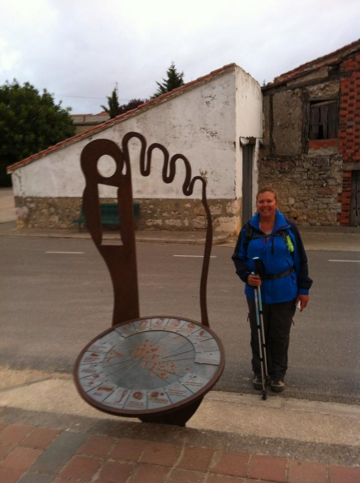 Tracy at a pilgrim sculpture in Orbaneja