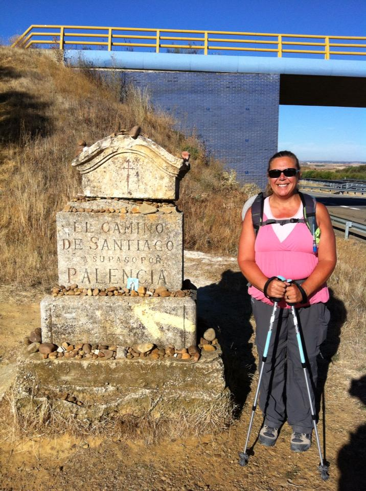 Tracy at a Palencia province marker near Sahagun
