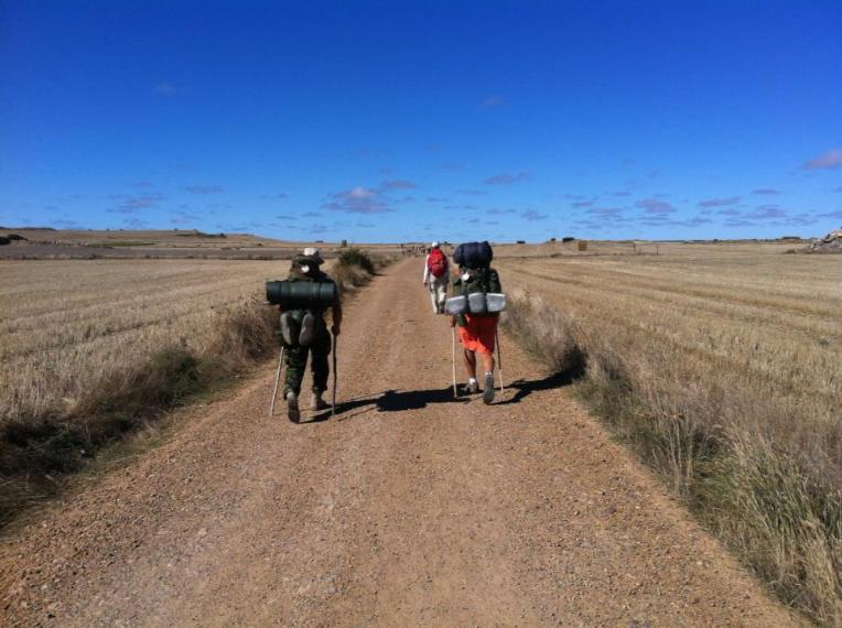 Pilgrim's crossing the Meseta between Rabe de las Calzados and Hornillos del Camino
