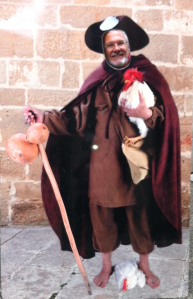 Alan posing at the cardboard cutout of a medieval pilgrim
