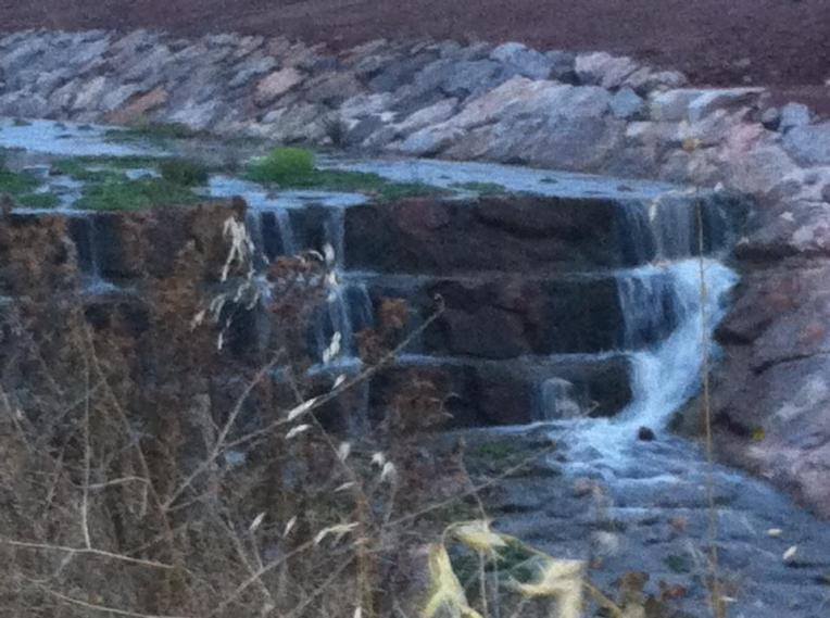 Small waterfall in canal near Ciruena