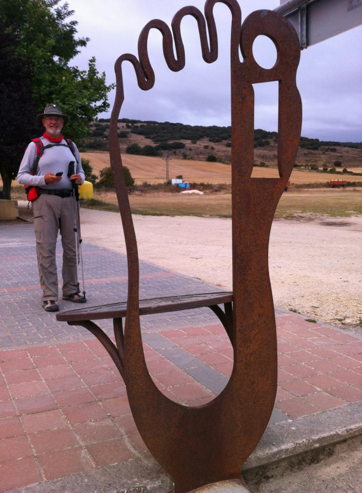 Alan at a pilgrim sculpture in Orbaneja