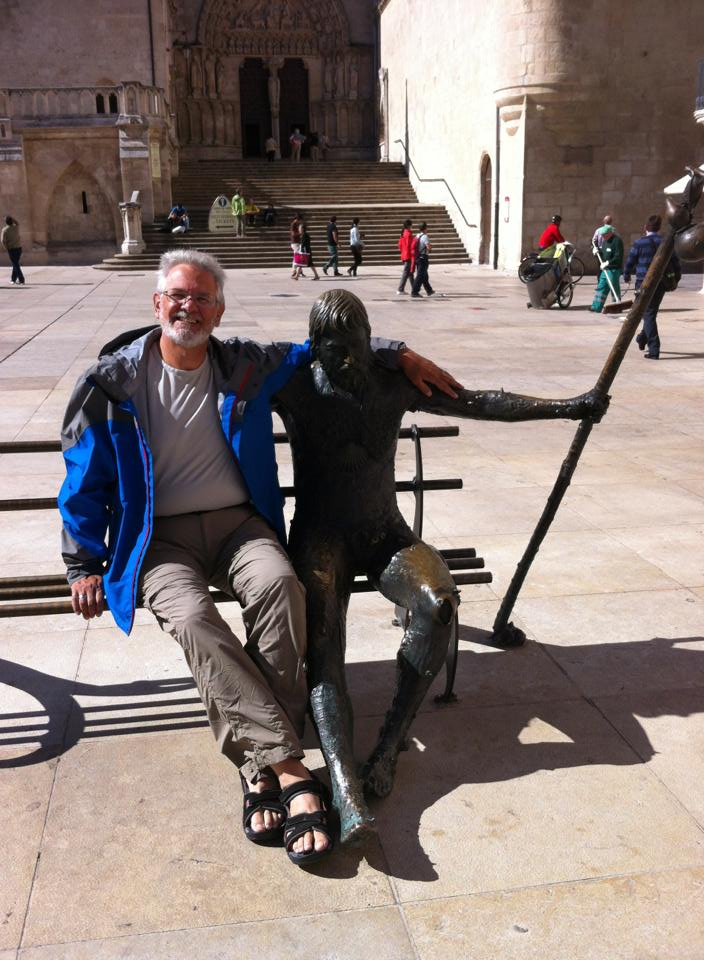 Alan beside bronze pilgrim sculpture, Plaza Santa Maria, Burgos
