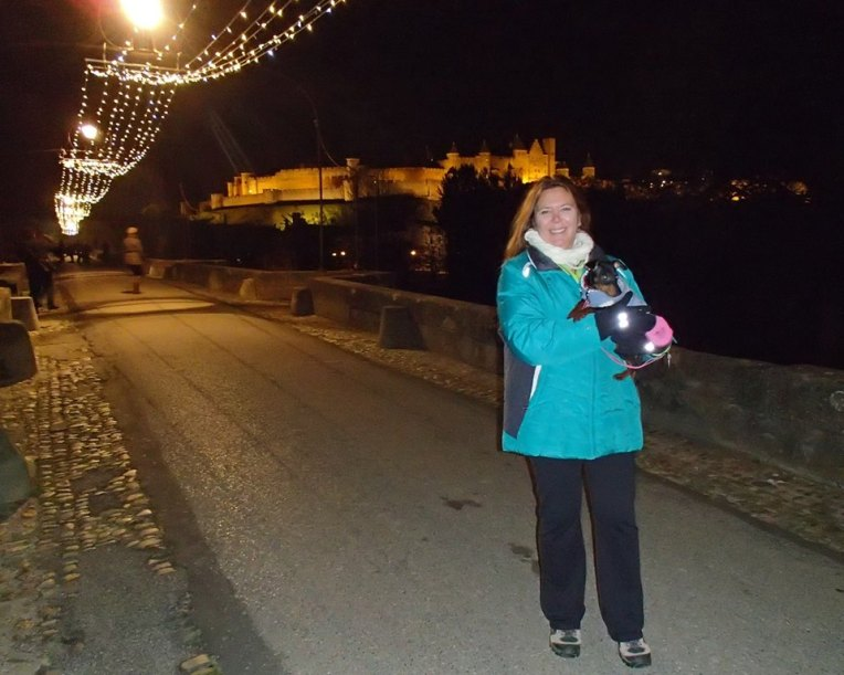 Tracy and Sami on the Pont Vieux (Old Bridge) waiting for the Marche aux Flambeaux (Torch March) to arrive.  La Cité de Carcassonne in the background.