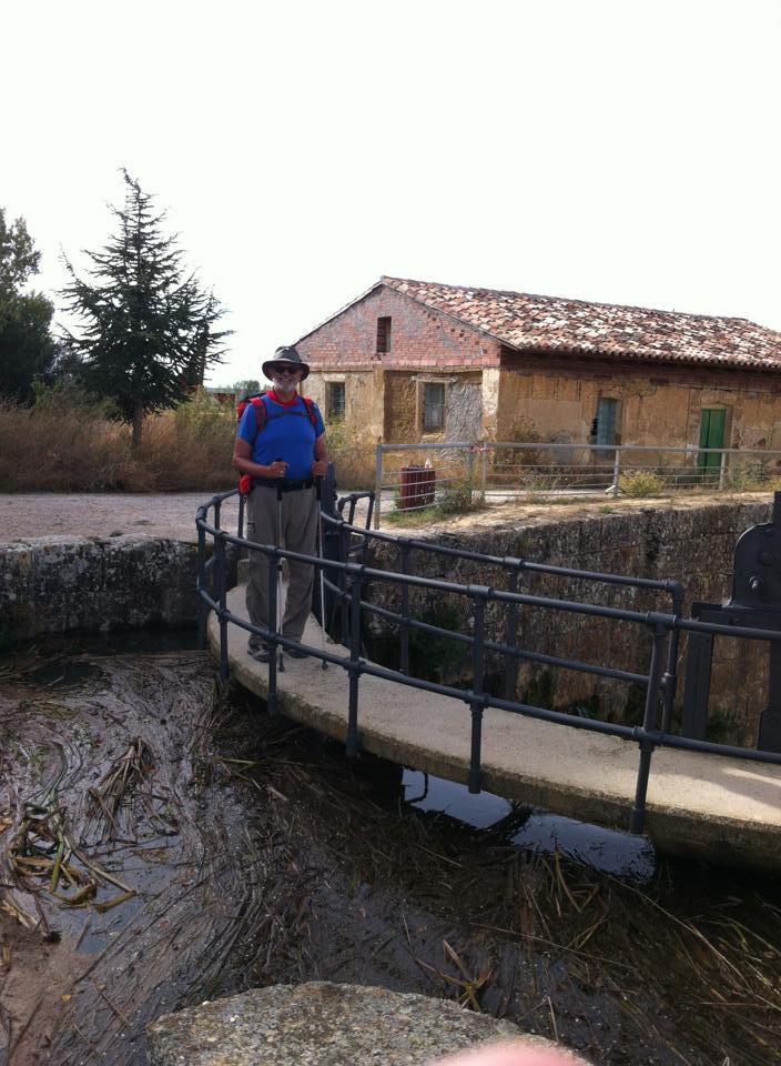 Alan crossing the lock on Canal de Castilla near Fromista