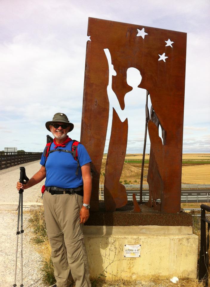 Alan at pilgrim sculpture on overpass near Itero de la Vega