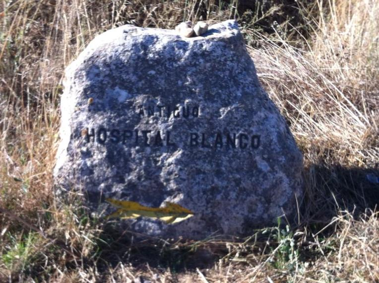 Camino marker marking the location of the Hospital Blanco an ancient pilgrim stop