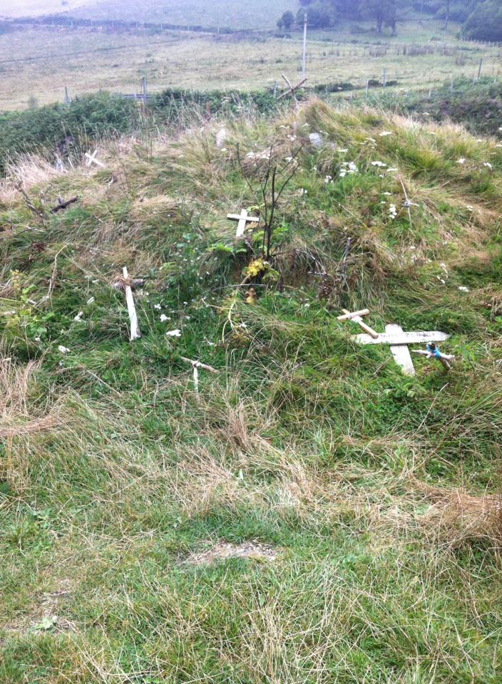There were hand-made crucifixes lay on a small hill next to the chapel