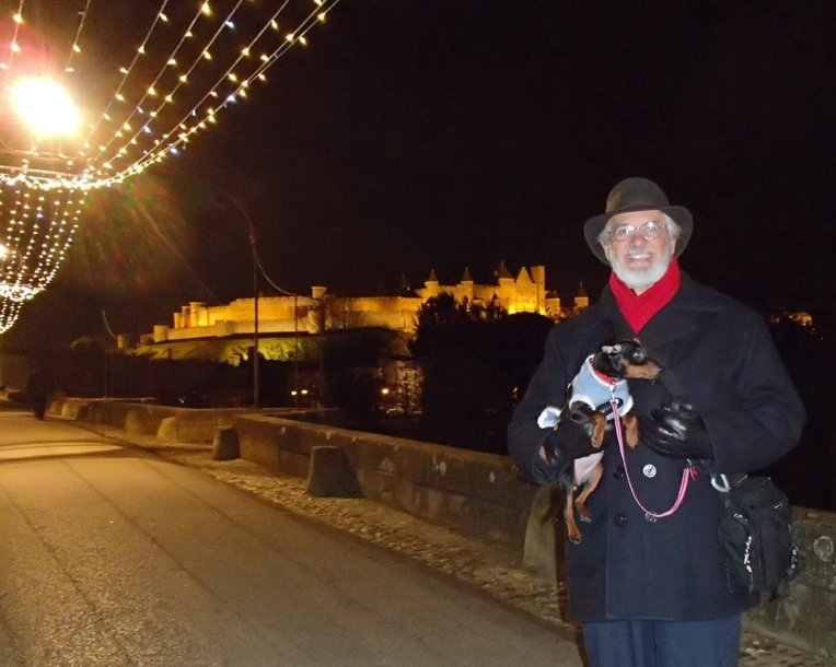 Alan and Sami on the Pont Vieux (Old Bridge) waiting for the Marche aux Flambeaux (Torch March) to arrive.  La Cité de Carcassonne in the background.