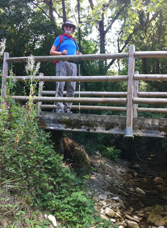 Alan crossing the wooden bridge at Irotz