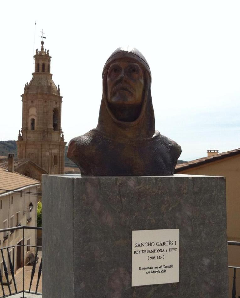 Bust of Sancho I and bell tower of San Andres, 12th century, in Villamayor