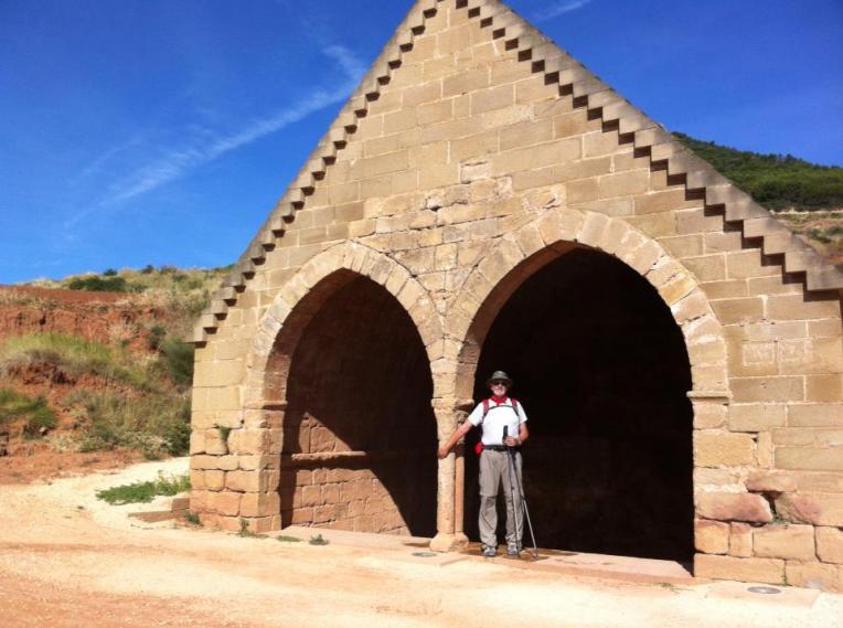 Alan at the double-arched entry of Fuente de Los Moros, 13th century