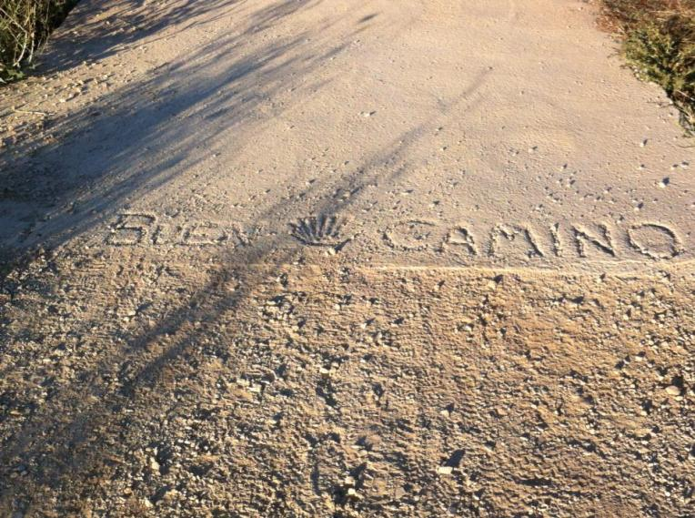 Buen Camino (Good Journey) in cement outside of Los Arcos