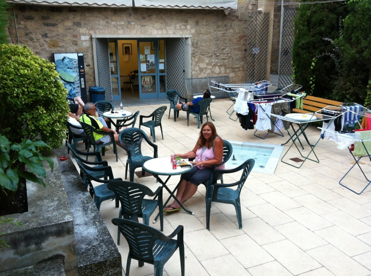 Tracy enjoying the patio at the albergue in Logrono