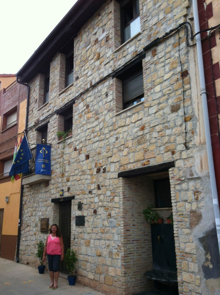 Tracy outside San Saturnino, our albergue in Ventosa