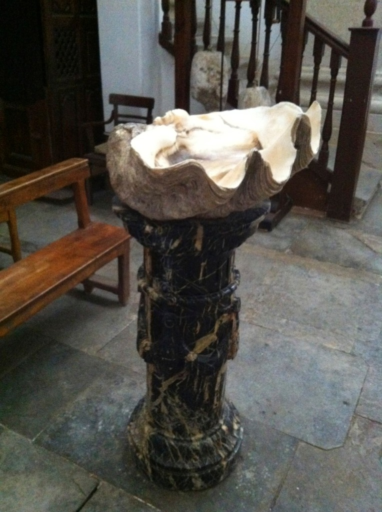 Holy water font made of a large scallop shell, its twin half is said to be in Rome, Chruch of Santiago,