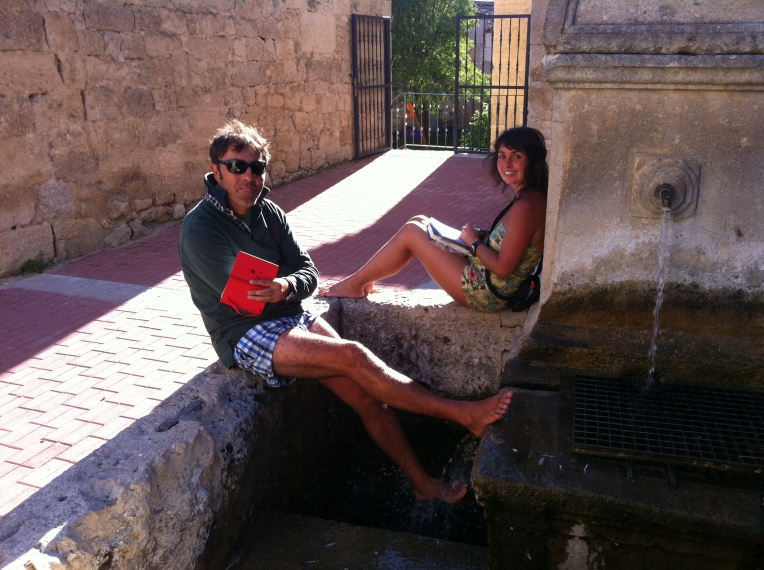 "Pilgrim's enjoying the ""fuente de peregrino"" in Hontanas"