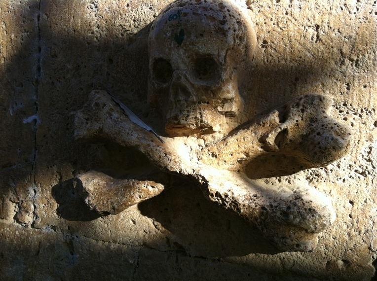 Skull and Crossbones detail, San Antón convent, 14th century
