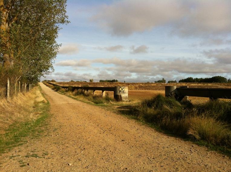 Farmland trail with raised aqueduct