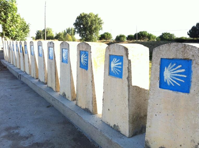 Markers lining the bridge in Población de Campos near the Senda