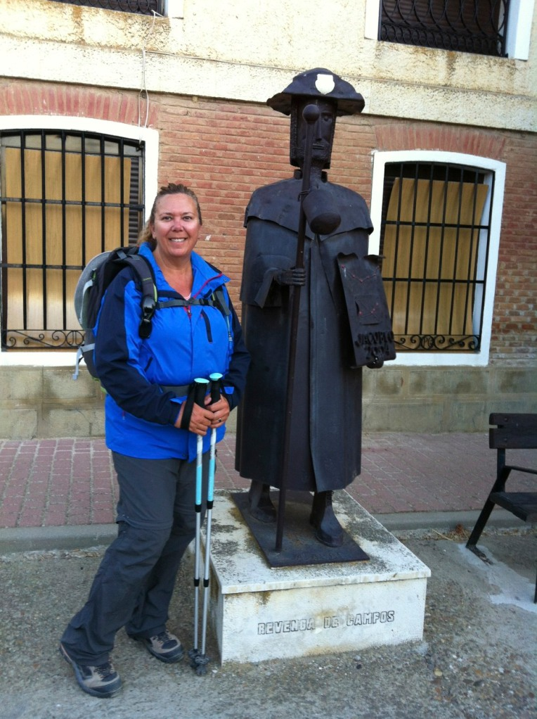 Tracy with pilgrim sculpture in Fromista