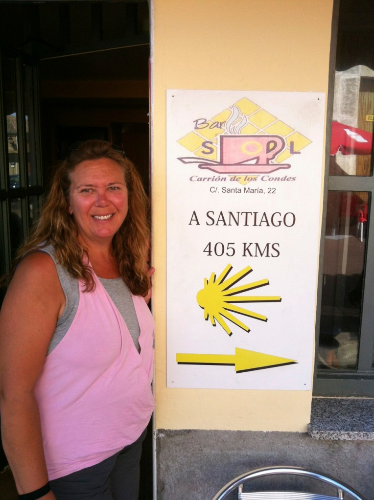 Tracy with mile marker at the café