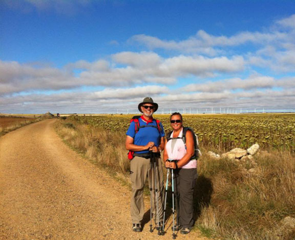 Camino | Alan and Tracy and view of a wind farm on the meseta of Spain
