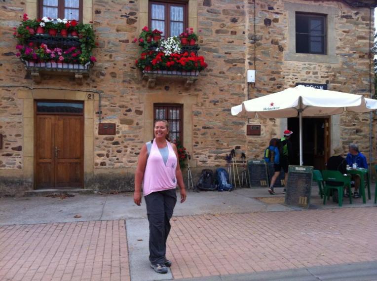 Tracy outside the café in Murias de Rechivaldo